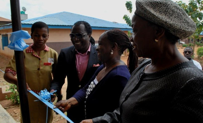 Chief Executive Officer, X3M Ideas Ltd, Steve Babaeko (middle) flanked by a Student of Opebi Junior Grammar School, Okeke Mary (left); President, Association of Advertising Agencies of Nigeria (AAAN), Mrs. Bunmi Oke and Principal of the School, Mrs. Temitope Harunna during the commissioning and handover of a block of 5 classrooms renovated by X3M Ideas to mark its 1st year anniversary in Lagos.