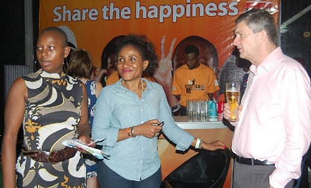 (R-L) Managing Director Nigerian Breweries Plc, Nicolaas Vervelde, Senior Brand Manager Maltina, Ngozi Nkwoji and the wife of the Managing Director, Clementine Vervelde at the opening show of Spanfest 2013 sponsored by Maltina in Lagos on Friday Night.