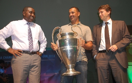 (L-R) Sales Director Nigerian Breweries Plc, Hubert Eze, Heineken Ambassador, Ruud Gullit and the Marketing Director Nigerian Breweries, Walter Drenth during the presentation of UEFA Champions League Trophy to Distributors