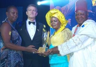 (L-R) Nigerian Breweries Managing Director' Wife, Clementine Vervelde, Managing Director Nigerian Breweries, Nicolaas Vervelde, National Champion of the Distributors Award, Dem Joy Igwe , husband Sir Gabriel at the presentation of the award in Lagos