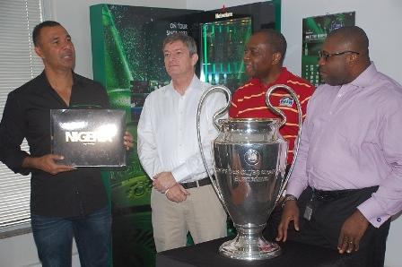 (L-R) Heineken Ambassador, Ruud Gullit, Managing Director Nigerian Breweries Plc, Nicolaas Vervelde, Human Resources Director, Victor Famuyibo and the Corporate Affairs Adviser, Kufre Ekanem at the internal presentation of Heineken UEFA Champions League trophy in Lagos