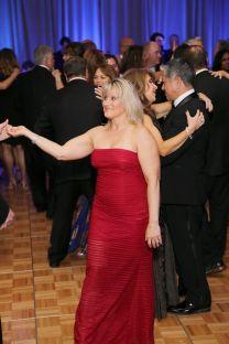Gala woman dancing to music