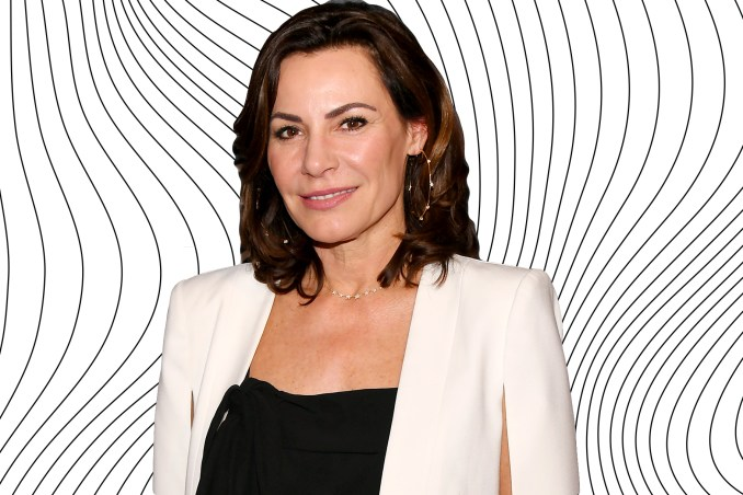 luann de lesseps changes hair: wears topknot bun hairstyle