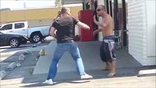 Two guys fight it out in the parking lot