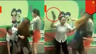 Catfight! Wife attacks husband's mistress with high heels on the street