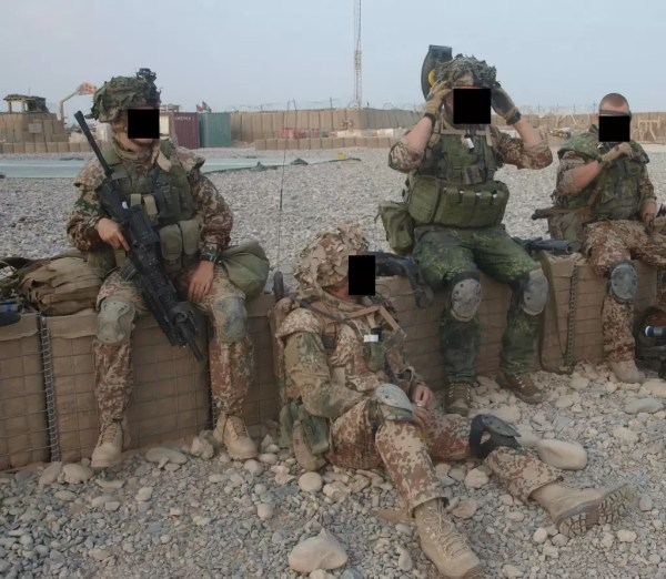 Mary with other soldiers before a patrol. Hard to tell which one she is? That's kind of the point.