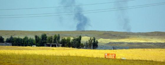 Smoke from explosions over the horizon - Kurdistan - by Michael Garcia
