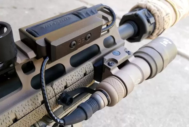 LCS Integrated Cable Clamp for an AR 15 flashlight.