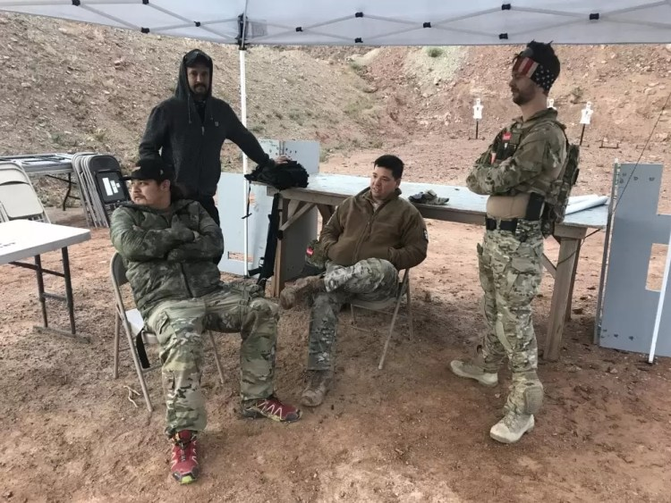 """Competitors from """"We Plead the Second"""" awaiting the start of the Rifle Dynamics Red Oktober AK-centric shooting competition."""