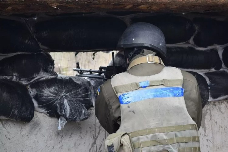 """A Ukrainian soldier in a defensive position near the Donbas """"Grey Zone."""""""
