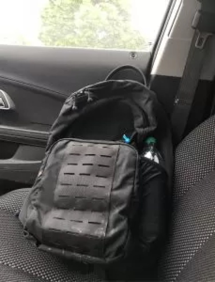 The Tracer pack has great exterior pockets, image of pack inside Big Joe's vehicle.