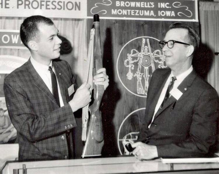 Frank and Bob Brownell showcasing a Latigo Sling at NRA Show.