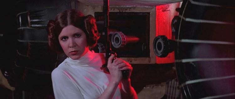 Guns of Star Wars - Princess Leia holding her DDC Defender.