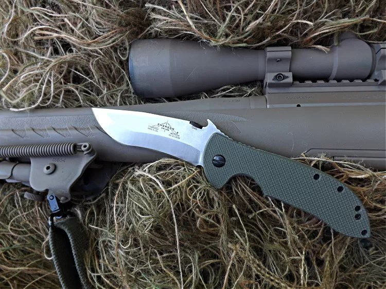 Emerson Commander folding knife and sniper rifle.