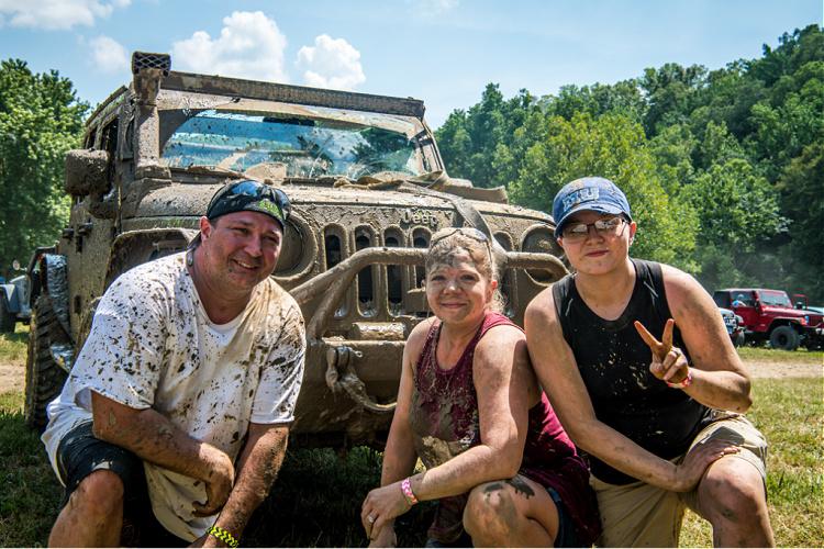 Family with their muddy jeep at TrailJam 2020 Loretta Lynn Ranch.