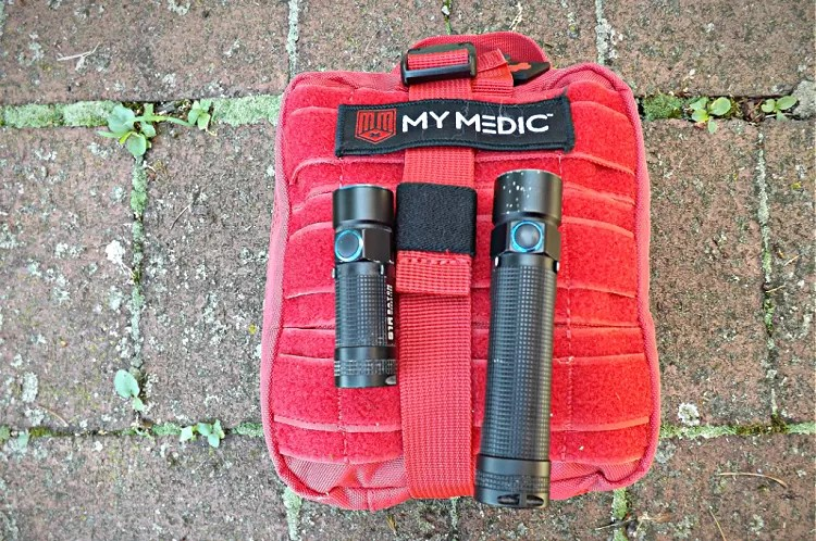 Olight flashlights with MyMedic medical kit.