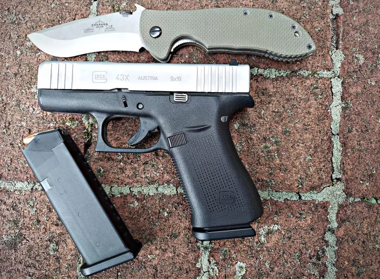 Glock 43X, spare magazine, Emerson Commander knife.