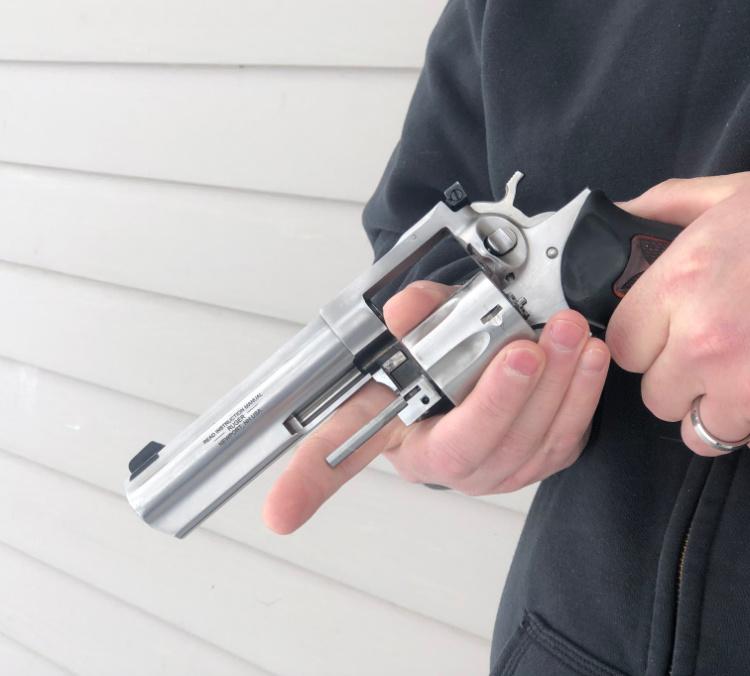 left handed revolver reloading step two, open cylinder