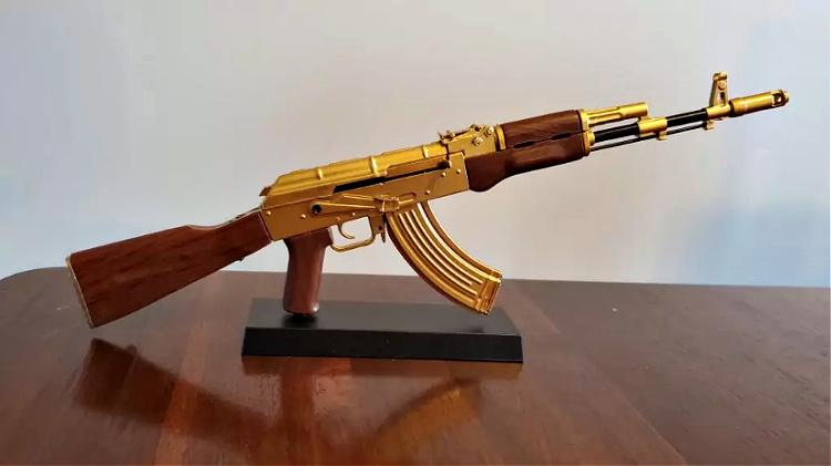 toy golden AK-47 display