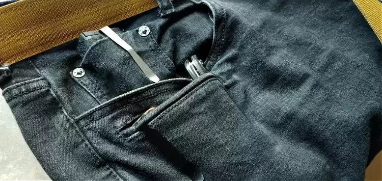 Viktos concealed carry jeans with EDC gear tucked into the pockets.