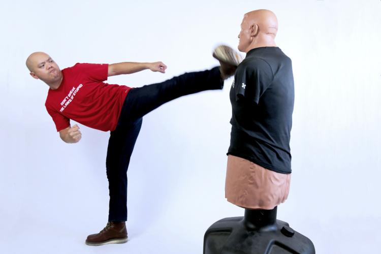 Patrick Vuong side kick wearing 5.11 flex jeans