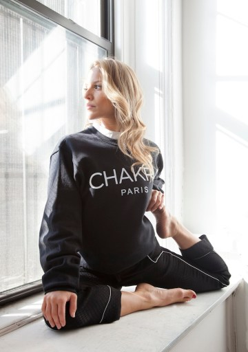 AcroYoga star Chelsey Korus models The Numinous Chakra sweatshirt