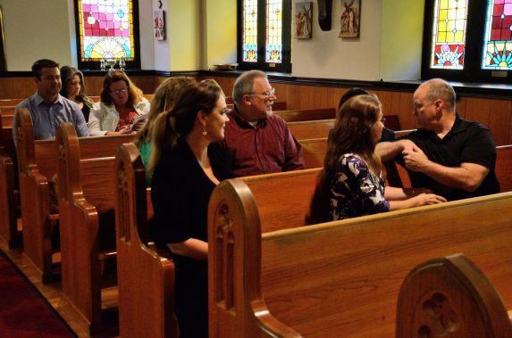 choir parents of the St Cecilia Choir, Christ Episcopal Church Springfield wait for the service at St. John's to begin