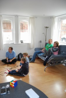 Pictures of the Allman Family playing on a games console