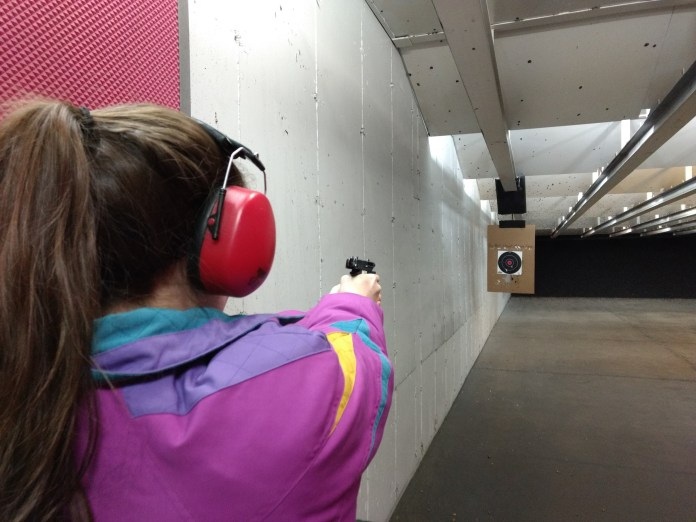 Lanie doing fine with the P238. I must have taken this after she'd emptied the magazine. The slide lock worked that time then.