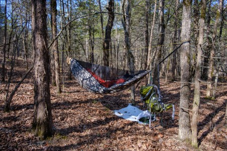 DutchWare Gear Chameleon hammock. When I first saw this picture I thought I'd set the hammock up wrong. Then I realized it's just the weight of the backpack pulling the near end down. Copyright © 2018 Gary Allman, all rights reserved.