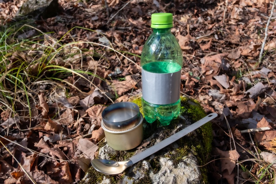 Fancee Feest Cat Can stove, Mountain Dew fuel bottle and a long titanium spoon. Copyright © 2019 Gary Allman, all rights reserved.