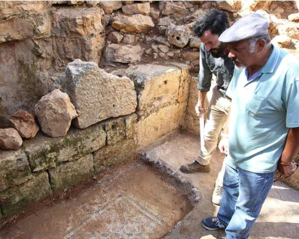 Excavation Site of Byzantine Church in Migdal Oz 23.3.16. Haim Shkolnik (L) and Hananya Hizmi (R) with the newly discovered mosaic. (Photo: Hillel Maeir/TPS)