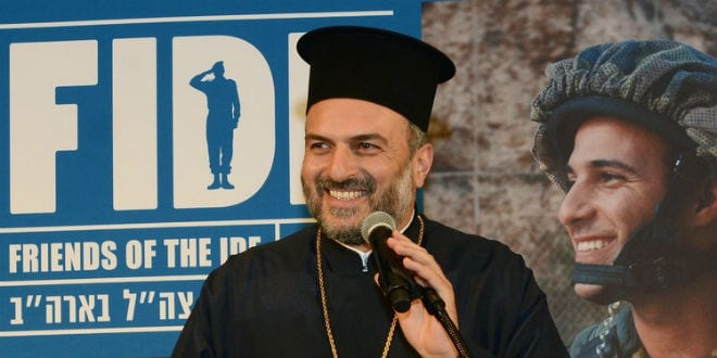 Father Gabriel Naddaf addresses the Friends of the Israel Defense Forces (FIDF) Texas Region gala on March 28 in Houston. (Photo: Alan Ross/JNS.org)