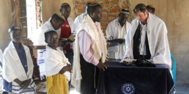 Members of the Abayudaya Jewish community pray in a synagogue near Mbale, Uganda. (Photo: Moshe Cohen via Wikimedia Commons. / JNS)