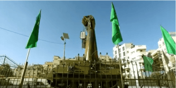 A statue of an iron fist holding Oron Shaul's dog tags in Gaza. (Video Screenshot)