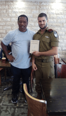 Remy Ilona with an IDF soldier in Israel. (Courtesy)