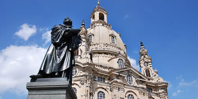 Martin Luther statue at the Dresden Frauenkirche, Church of Our Lady is a Lutheran church in Dresden, eastern Germany. (Meunierd/Shutterstock)