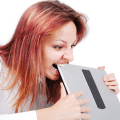 A woman with so much anxiety and stress that she's trying to eat her laptop. Ouch!