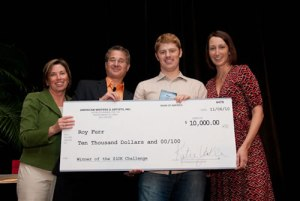 "Here I am, being awarded a $10,000 ""big check"" prize as the industry's hottest up and coming direct response copywriter at AWAI's 2010 Bootcamp!"