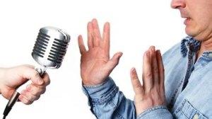speaker-refusing-microphone