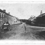 Horse and cart passing through Powburn