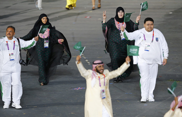 Members of Saudi Arabia's contingent take part in athletes parade during opening ceremony of London 2012 Olympic Games at Olympic Stadium