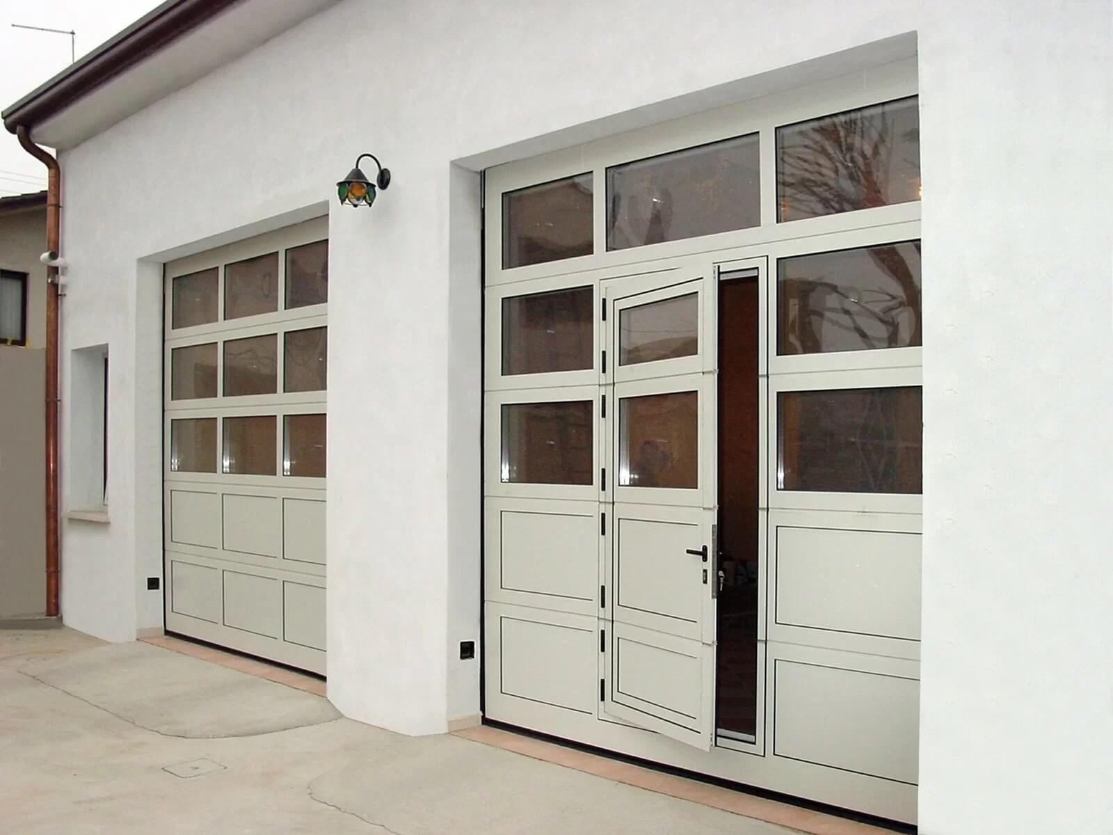 Portone sezionale vetrato LUXOR - Portone Sezionale Breda Luxor porta pedonale