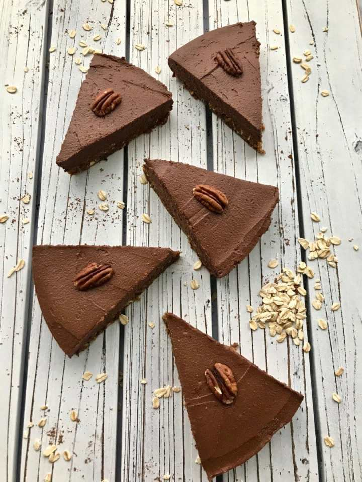 Slices of chocolate sweet potato pie with pecans on top.