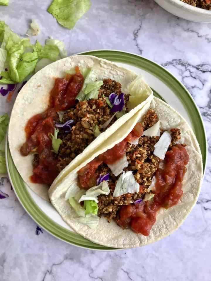 Vegan cauliflower tacos with salsa and lettuce.