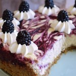 A velvety smooth gluten free Blackberry Swirl Granola Cheesecake with a buttery granola crumb crust. Serve with fresh blackberry puree and whipped cream for a rich and decadent dessert.