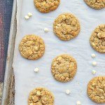 Soft batch Gluten Free Coconut White Chocolate Chip Macadamia Cookies are full of coconut flavor with pockets of melted white chocolate chips and some roasted macadamia pieces for a little crunch.