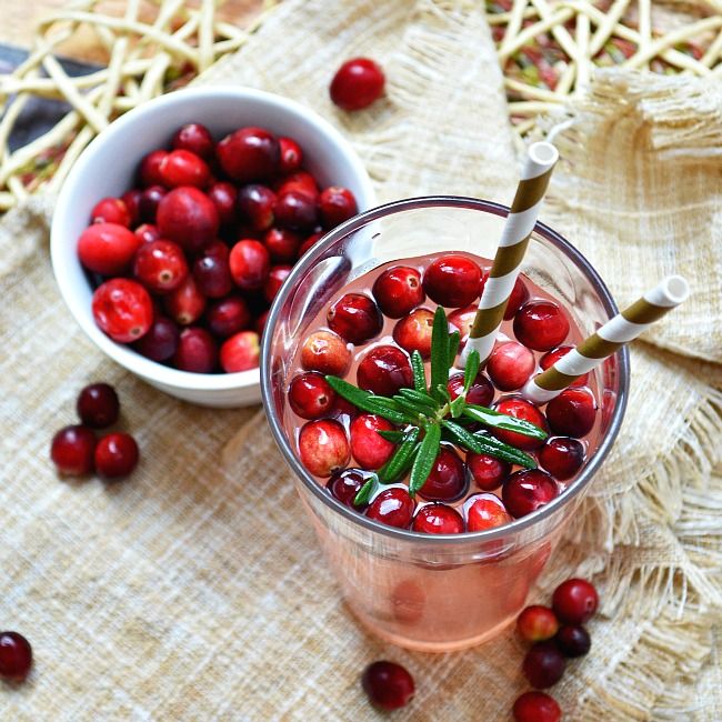 Ring in some holiday cheer with this sweetly refreshing Fresh Squeezed Cranberry Almond Lemonade.