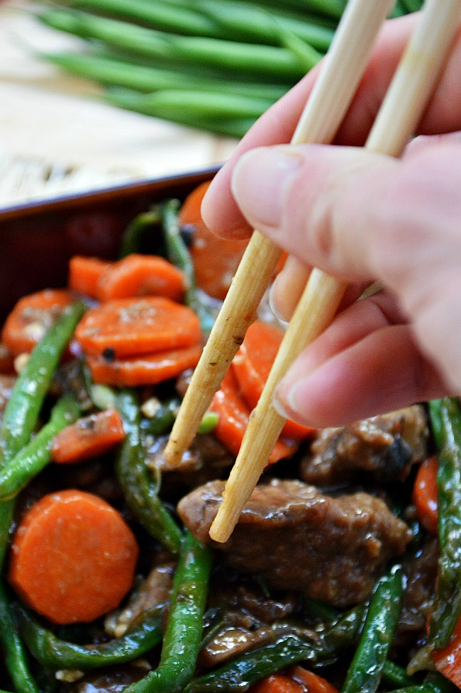 Whip up this Gluten Free Green Bean and Carrot Beef Stir Fry for a quick 30 minute week night meal. It's full of veggies and full of flavor!
