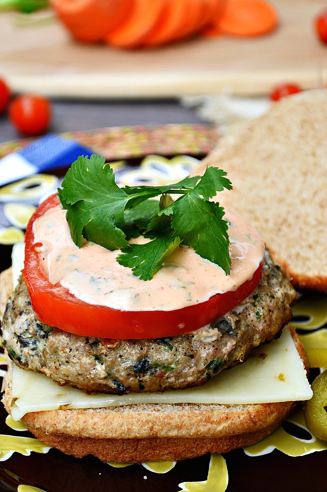 Take a break from red meat burgers and dive into these flavorful Gluten Free Cilantro Ginger Turkey Burgers with Sriracha Mayo.